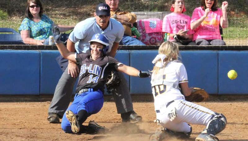 CO-LIN MEDIA / NATALIE DAVIS / Co-Lin shortstop Brooke Laigast slides safely into home as the Lady Bulldog catcher Dani Craft tries to make the play.