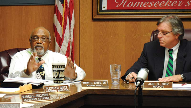 "THE DAILY LEADER / JUSTIN VICORY / Ward Two Alderman Terry Bates (left) proposes the board of aldermen consider the full-time hire of a solid waste department employee. ""This is absolutely necessary,"" Bates said."