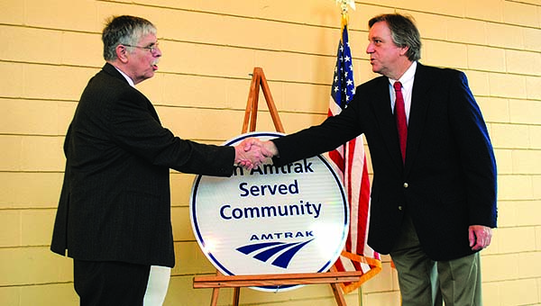 THE DAILY LEADER / JUSTIN VICORY / Amtrak CEO Joe Boardman shakes Mayor Joe Cox's hand after unveiling a plaque at the Godbold Transportation Center Wednesday.