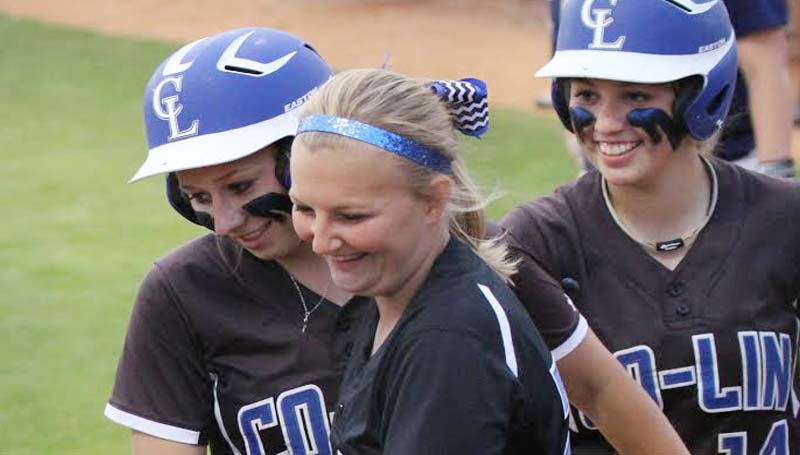 CO_LIN MEDIA / NATALIE DAVIS / Co-Lin's Beth Fortenbery (far left) is congratulated by teammates Peyton Sheffield (center) and Brooke Laigast after hitting a 3-run home run.