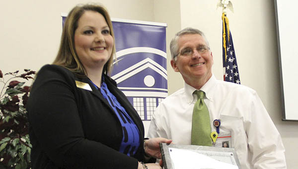 Dean of Career, Technical, and Workforce Education Jackie Martin (left) presents King's Daughters Medical Center CEO Alvin Hoover with the President's Award at the Business and Industry Appreciation Luncheon held Thursday at The Thames Center on Co-Lin's Wesson Campus.