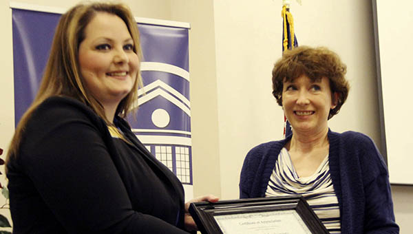 Dean of Career, Technical, and Workforce Education Jackie Martin (left) presents Teresa Odom of Puckett Machinery with a Special Recognition Award at the Business and Industry Appreciation Luncheon.