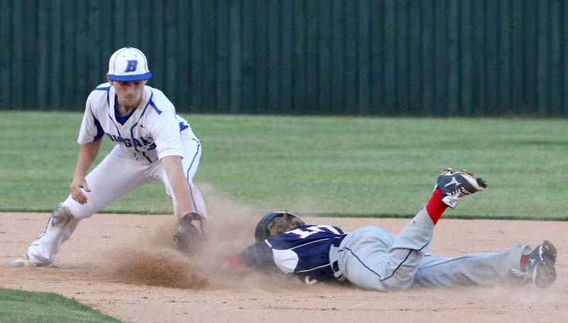 DAILY LEADER / SHERYLYN EVANS / Brookhaven Academy second baseman Zack Dickerson tags out Drew Caston (10) on an attempted double play Friday night at Harold-Williams Ballpark.