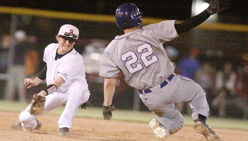 DAILY LEADER / JONATHON ALFORD / Brookhaven's shortstop Myles Tipton stretches to apply the tag on Pearl River Central runner Jake Scheurman (22) Friday night.