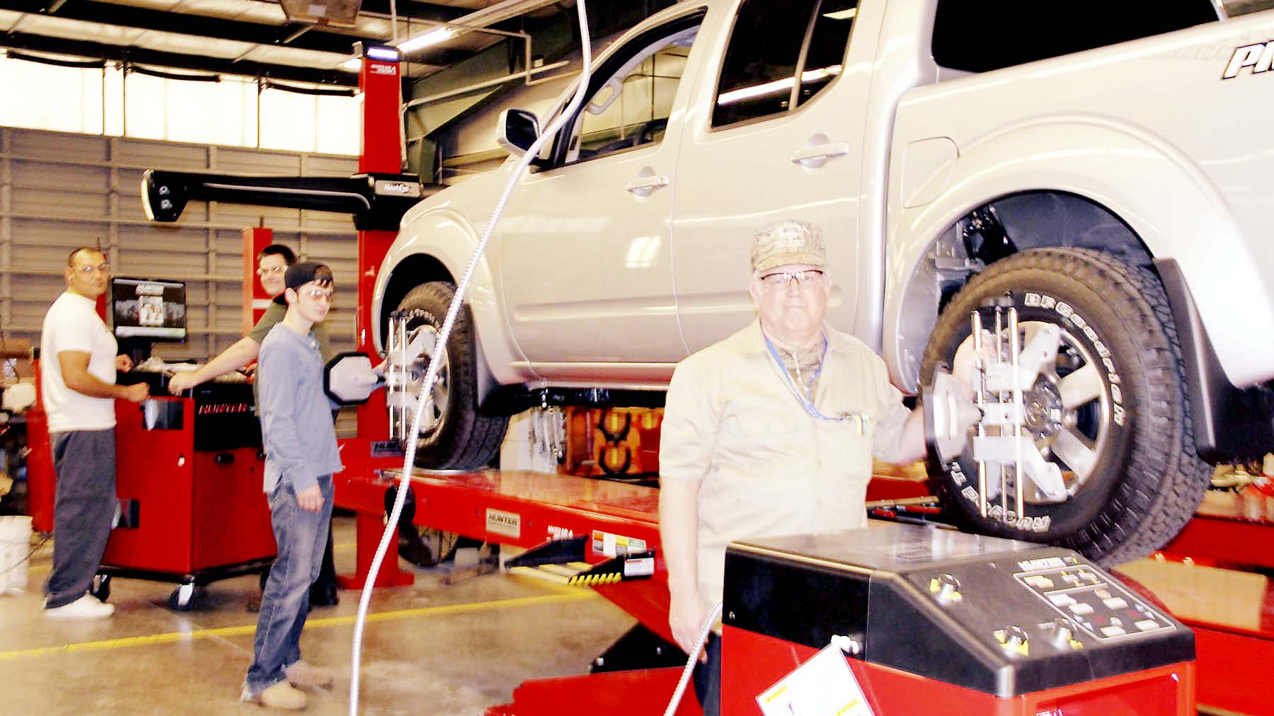 PHOTO SUBMITTED / Automotive technology students Paul Rejon (from left) of Brookhaven, Michael Butler of Bogue Chitto, Nicholas Devine and Wesley Bearden, both of Brookhaven, work with some of the new equipment in the automotive technology program at Copiah-Lincoln Community College.