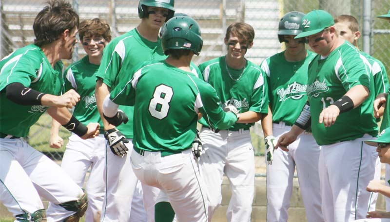 DAILY LEADER / MARTY ALBRIGHT / West Lincoln Ty Forman (8) is greeted at home plate after hitting a three-run home run in the fifth inning against South Pike Saturday.