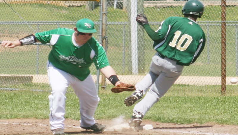 DAILY LEADER / MARTY ALBRIGHT / West Lincoln Tyler Moak adjusts to make a play at first base as South Pike runner Jesse Jordan (10) reaches safely Saturday.
