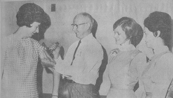 PHOTO SUBMITTED / In 1968 Junior Auxiliary volunteers were busy making sure everyone was vaccinated for measles. A picture in the Leader-Advertiser - a predecessor of The Daily Leader - shows Howard Boone, public health adviser with the Mississippi State Board of Health, injecting Mrs. Russell Burns with a new jet injector instrument used in administering the measles vaccine. Other JAs pictured are Mrs. Clark Arrington (center) and Mrs. Jerald Nations.