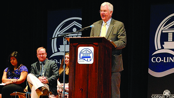 THE DAILY LEADER / RHONDA DUNAWAY / Mississippi Community College Board Executive Director Dr. Eric Clark (at the podium) speaks to an audience in Rea Auditorium about the C4 initiative that encourages completion of community college with a certificate  or degree. Also pictured are members of the Eta Omega Chapter of Phi Theta Kappa (from left) and Co-Lin President Dr. Ronnie Nettles. Clark is touring Mississippi's community colleges and spoke at Co-Lin Monday.