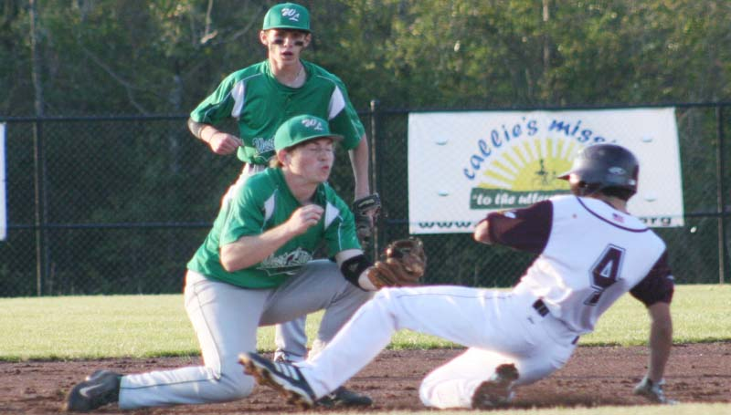 DAILY LEADER / MARTY ALBRIGHT / West Lincoln shortstop Bryce Temple tags out Enterprise runner Reese Brocato (4) sliding into second base as teammate Tanner Boutwell looks on Tuesday night.