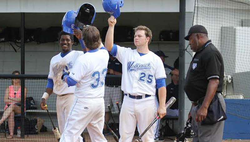 CO-LIN MEDIA / NATALIE DAVIS / Co-Lin's Mitch Little (33) is greeted by teammates Choc Hubbard (left) and Logan Smith (25) after hitting a two-run home run.