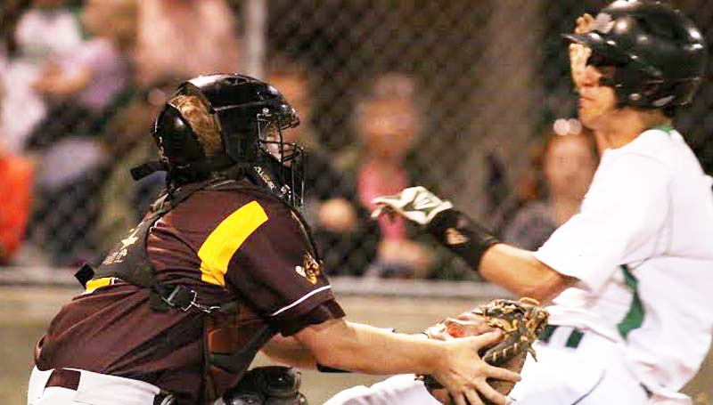 DAILY LEADER / JONATHON ALFORD / Enterprise catcher Max Miller tags out West Lincoln runner Chase Buckles in Friday night action.