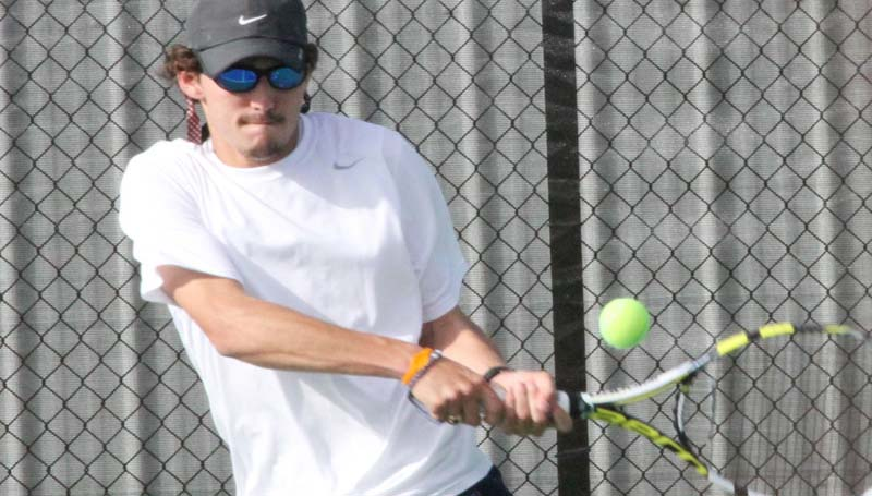 CO-LIN MEDIA / NATALIE DAVIS / Co-Lin's Coleman Carraway helps the Wolves defeat Hinds in tennis action Saturday.