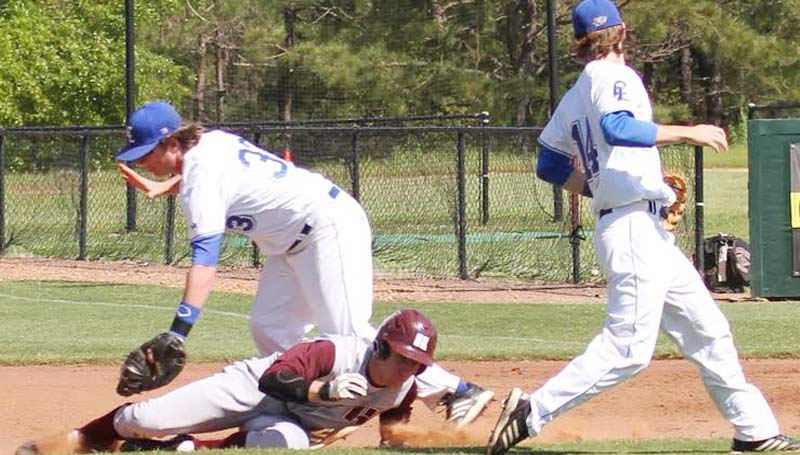 CO-LIN MEDIA / NATALIE DAVIS / Co-Lin's Mitch Little (33) tags out Hinds runner Luke Reynolds in the rundown as teammate Ryan Young (14) looks on.