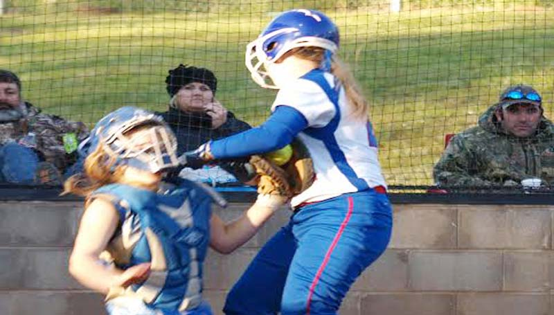 DAILY LEADER / TRACY FISCHER / Tylertown's catcher Rachel Hope (left) managed to secured the out at home plate as Wesson's runner Bailey Middleton plows into her Tuesday night.