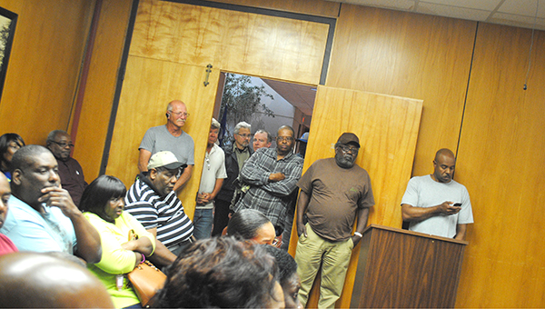 City workers, mostly from the solid waste department, crowd into the aldermen meeting Thursday night.