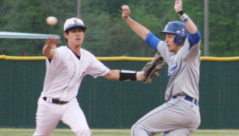 DAILY LEADER / MARTY ALBRIGHT / Pearl River Central runner Christian Travis (right) gets caught in a rundown by Brookhaven's second baseman Stone Case in Thursday night baseball action.