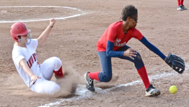 DAILY LEADER / SCOTT BOYD / Loyd Star Lady Hornet Johnna Norman slides into third base during Tuesday night's win over visiting East Marion.