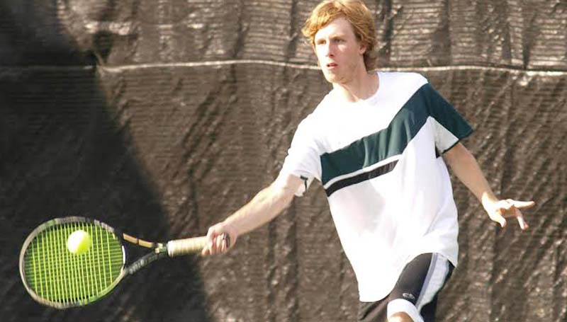 DAILY LEADER / TRACY FISCHER / West Lincoln's Gage Butler returns a serve in Boys No. 1 Doubles action against Clarkdale.
