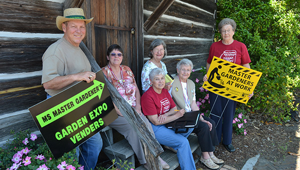 THE DAILY LEADER / RACHEL EIDE / Lincoln County Master Gardeners who were in Railroad Park this week getting ready for the group's upcoming Gardening Extravaganza are (from left) Steve Edge; Cathy Ivy, 2014 vendor chairman; Barbara Breaux (front), Master Gardeners treasurer and state board member; Shirley Estes (back); Kaye Kaberlein, vice president; and Edna Bishop, president. The Gardening Extravaganza is from 8:30 a.m. until 4:30 p.m. Saturday in the park. Vendors will be set up throughout the day, educational seminars start at 10:30 a.m. in the Brookhaven-Lincoln County Chamber of Commerce, and there will be a picnic in the park from 11:30 to 1 p.m. with hamburgers, drinks and ice cream for sale.