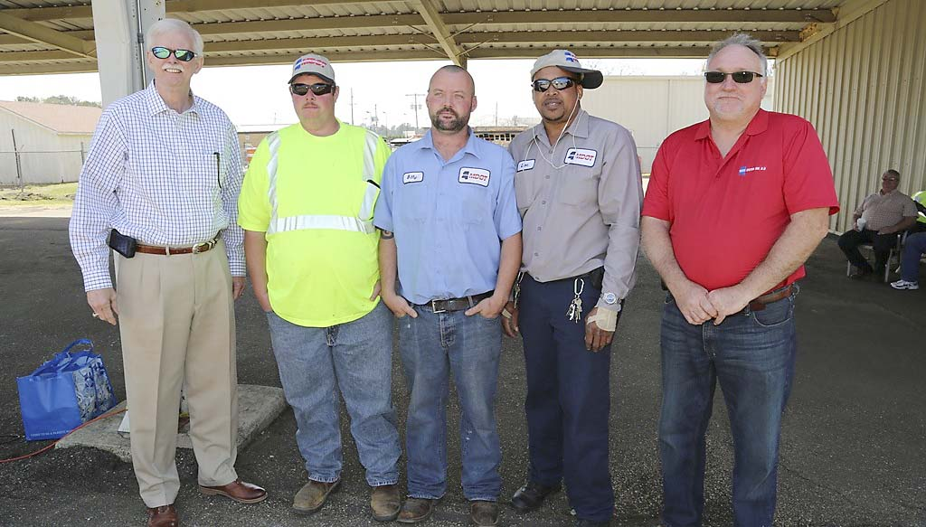 "PHOTO SUBMITTED / The 2014 Equipment Operators ""Roadeo"" kicked off with the District 7 Roadeo on March 20 in McComb. The first, second and third place winners of the backhoe category are pictured  with Southern Transportation Commissioner Tom King (left) and Bobby Wells (right), District 7 maintenance engineer. Winners are (from second from left) Jason Moak, second place; Billy ""Bejay"" Norris, first place; Leon Veals, third place."