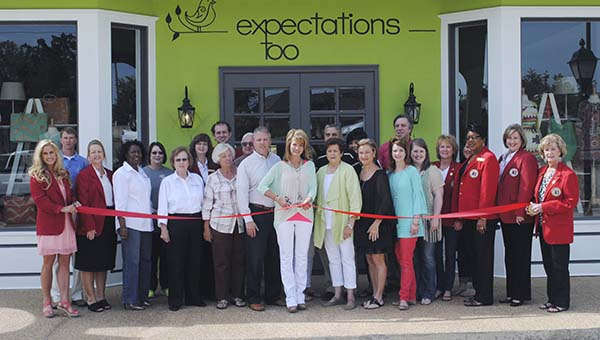 DAILY LEADER / RHONDA DUNAWAY / Mayor Joe Cox (back row, far right), Brookhaven-Lincoln County Chamber of Commerce President Dustin Walker (back row, far left), Executive Director Garrick Combs and chamber members and ambassadors were on hand for a ribbon cutting for the new retail space of Expectations Too. With business owner Angela Warren (center with scissors) is Lib Smith (right), and Warren's husband Beck Warren (left). Next to Beck Warren are his parents, Kenneth and Patsy Warren.