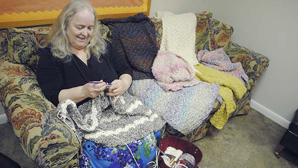 DAILY LEADER / RHONDA DUNAWAY /Emily Rossie crochets a prayer shawl at the Episcopal Church of the Redeemer Wednesday. Rossie made her first prayer shawl for a sick relative in 2005 and has helped start a shawl ministry with the Redeemer Episcopal Church Women.