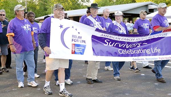 The survivors take to the track for a lap during the Lincoln County Relay for Life for the American Cancer Society Friday evening.