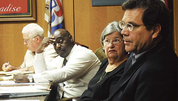 DAILY LEADER / JUSTIN VICORY / Ward One Alderman Randy Belcher (from left), Ward Four Alderman Shirley Estes and Ward Six Alderman David Phillips listen to the discussion of the city water and sewer project Tuesday night.