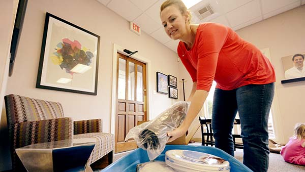 DAILY LEADER / KATIE WILLIAMSON /  Sloane Smith drops off her donations for tornado victims at BelkDitcharo Wednesday. The Junior Auxiliary of Brookhaven is conducting a relief drive for Louisville, one of the areas hardest hit by the April 28 storms.