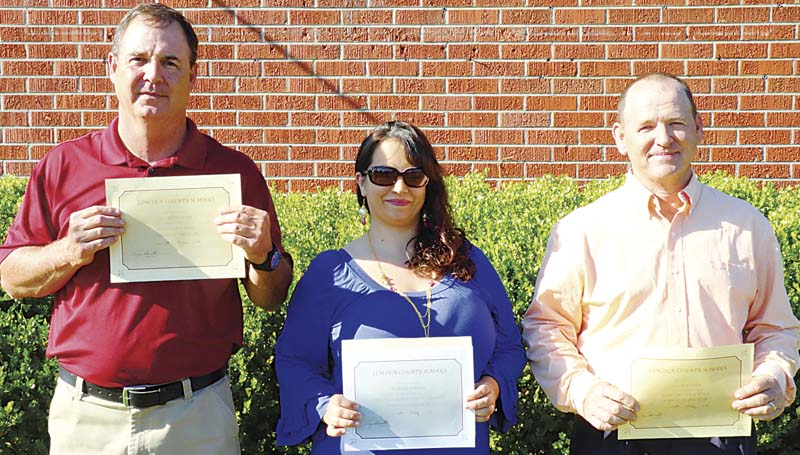 PHOTO SUBMITTED / The Lincoln County School District's Parents of the Year are David Flowers (from left) of Loyd Star Attendance Center, Patricia Jordan of Enterprise Attendance Center and Hugh Mathis from West Lincoln Attendance Center. Not pictured is Mary Jordan of Bogue Chitto. Jordan was recognized as District-wide Parent of the Year.
