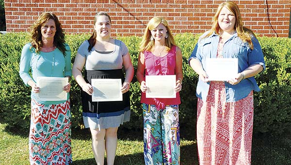 PHOTO SUBMITTED / Lincoln County School District recognized Teachers of the Year at the Monday school board meeting. Belinda Spears (from left) of West Lincoln Attendance Center, Kristy Cline of Enterprise Attendance Center, Julie Akins of Bogue Chitto Attendance Center and Katie Furr of Loyd Star Attendance Center were all honored. Furr was recognized as District Teacher of the Year.