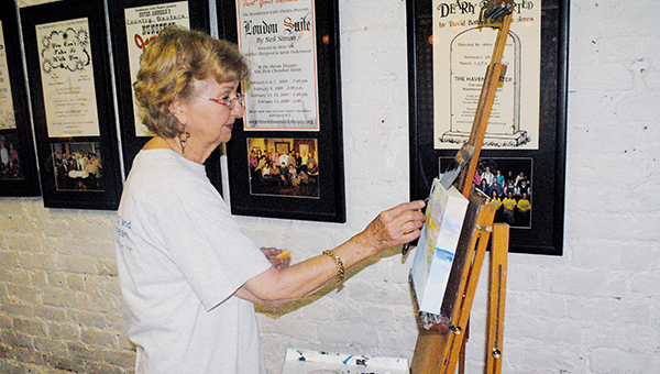 "DAILY LEADER / JUSTIN VICORY / Maxine Minter of the Brookhaven Regional Art Guild entertains theater-goers Friday night at The Haven, as she paints onsite during BRAG's Art Walk, held in conjunction with the opening of Brookhaven Little Theatre's musical, ""The Music Man."" For a review of the play, please see page five."
