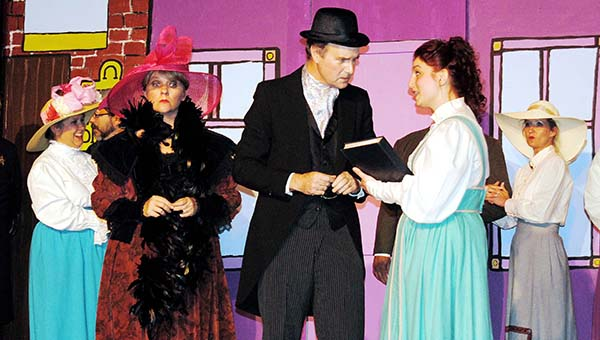 "PHOTO SUBMITTED / MATTHEW COLEMAN / Marian Paroo, played by Phoenix McKissack (right), provides Mayor Shinn, played by James Minter, with evidence on a suspicious Harold Hill as the mayor's wife Eulalie, played by Celeste Lowery (left), looks on during a scene from Brookhaven Little Theatre's production of ""The Music Man."" The play opened Friday night and continues Sunday and next Friday and Saturday at the Haven Theatre on West Cherokee Street in downtown Brookhaven."