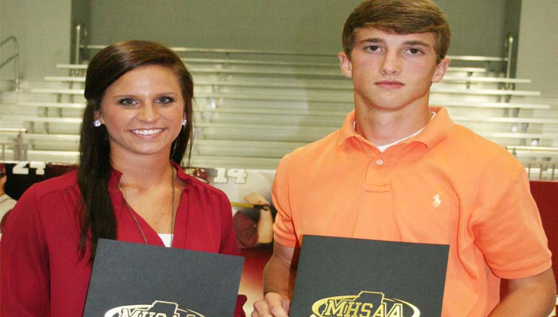DAILY LEADER / MARTY ALBRIGHT / Enterprise Cass Brister recognizes two nominees for the Lindsey Callahan Award during the school's athletic banquet. The nominees are Ashley Boyd (left) and Jackson Cole.