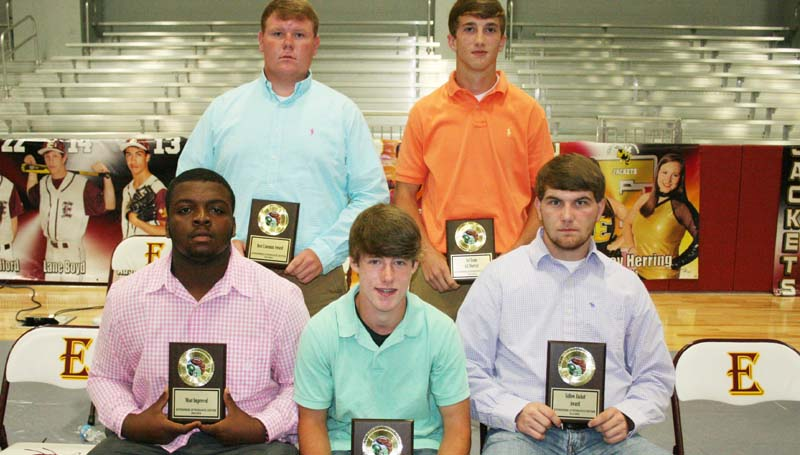DAILY LEADER / MARTY ALBRIGHT / The Enterprise Yellow Jackets football team was honored during the school's athletic banquet. Players receiving awards were (seated, from left) Adam McGee, Most Improved; Tristan Cantrell, Most Valuable Special Teams Player; James King, Yellow Jacket Award; (Standing) Colton Welch, Best Lineman; Jackson Cole, Best Back, Most Valuable Offensive Player, All-District.