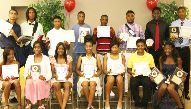 DAILY LEADER / MARTY ALBRIGHT / Brookhaven's Track and Field Panthers receiving special awards at Thursday night's banquet were (from left, seated) Artia Robinson; Arnancy Arnold, Most Valuable Distance Runner, Most Valuable Player; Jerricka Williams, Most Valuable Sprinter; Mya Newton, Most Improved; Fredericka Fairman, Therrell Tanner Award; Diamond Herring, Scholastic Award; Waverli Culver, Team Captain, Most Valuable Field Event; (standing) Scottie Tate, Scholastic Award; Kiantrei Thomas, Team Captain, Most Improved, Most Valuable Distance Runner; Ben Robinson, Panther Award; Shuntez Smith, Most Valuable Sprinter; Terrance Morgan; Tyler Thomas, Therrell Tanner Award; Chris Calcote, Most Valuable Field Event, Most Valuable Player; and Marte Jones, Coaches Award.