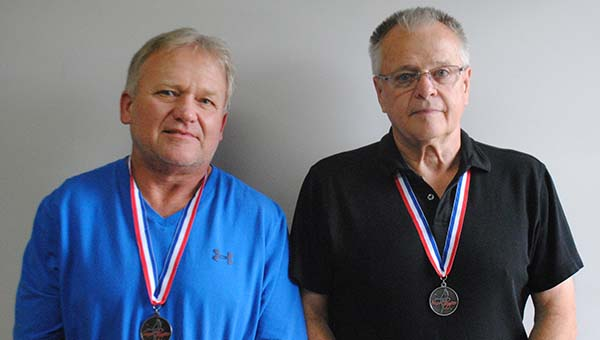 DAILY LEADER / JUSTIN VICORY / Fellow Olympiads Butch Ayers (left) and D.C. Greer show off their medals Friday. Ayers, Greer and Larry Mills (not pictured) won the medals at the Mississippi Senior Olympics. It was a qualifying event for the National Senior Olympics, to be held in July of 2015.