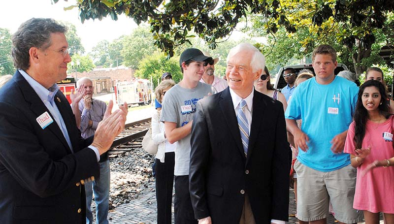 DAILY LEADER / JULIA V. PENDLEY / U..S. Rep. Gregg Harper (left) introduces Sen. Thad Cochran (right) during a picnic in Railroad Park Friday.