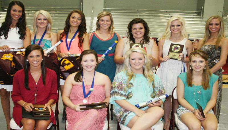 DAILY LEADER / MARTY ALBRIGHT / The Enterprise Cheerleading team was honored during the school's athletic banquet. Players receiving awards were (seated, from left) Ashley Boyd, Sr. Cheer; Whitney Herring, UCA All-American, Sr. Cheer; Brianna Dunaway, Sr. Cheer, Captain Award, Coaches Award; Ahna Thamasee, Sr. Cheer; (Standing) Monica Amic, Coaches Award; Sara Harper Dunaway, UCA All-American; Samantha Stuart, Fire Up Award; Maddie Carter, Yellow Jacket Award; Savanna Dunaway, Best Cheerleader, Coaches Award, Penit Ford Award; Rainee Luper, Most Improved.