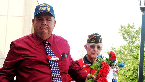DAILY LEADER / JULIA V. PENDLEY / Ray Glass (left front) and Billy Hughes present the wreath to be laid at the Lincoln County Veterans Memorial Monday morning.