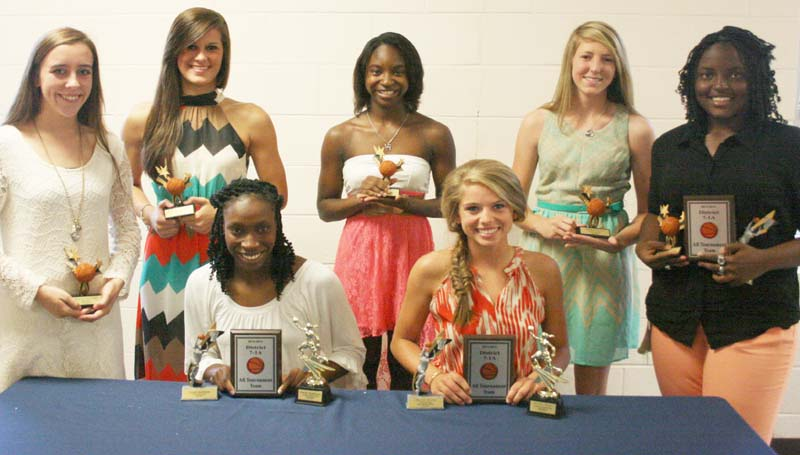 DAILY LEADER / MARTY ALBRIGHT / The Bogue Chitto girls' basketball team was honored during the school's athletic banquet. Players receiving awards were (seated, from left) Zariah Matthews, Co-Most Valuable Player, All-District, All-County; Mattie Avants, Co-Most Valuable Player, All-District, All-County MVP; (Standing) Karlie Williams, Ms. Hustle; Lauren McCaffery, Post Player Award; Taneshia May, Most Valuable Defensive Player; Terrah Nelson, Rookie of the Year; Christian Black, Most Valuable Offensive Player, All-District, All-County.