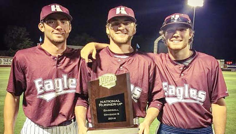 DAILY LEADER / Photo Submitted / Local Brookhaven players (from left) Gage Posey, Houston Case, Andrew Culver proudly holds the JUCO National runner-up trophy. The freshmen pitchers represented Lincoln County as the Hinds Community College Eagles made a historic run the NJCAA College World Series and finished second in the championship contest.