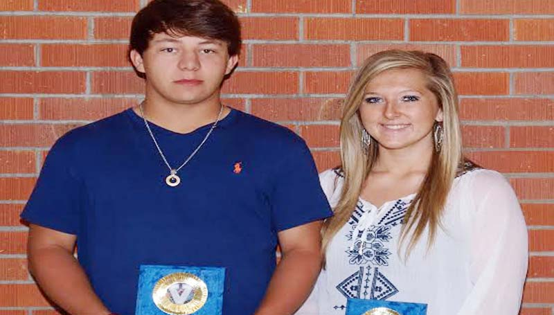 DAILY LEADER / TRACY FISCHER / DENNIS WHITE AWARD - Wesson's Spring Athletic banquet recognized Dennis White Award winners Justin Boone (left) and Bailey Middleton.