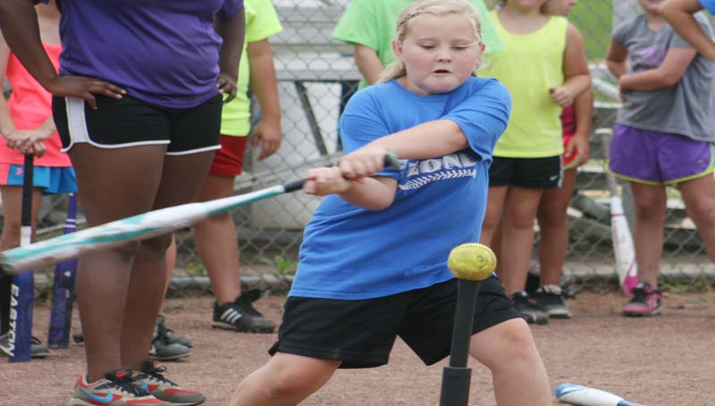 DAILY LEADER / MARTY ALBRIGHT / Alyssa Leggett hits the ball hard during a drill at Bogue Chitto's softball camp.