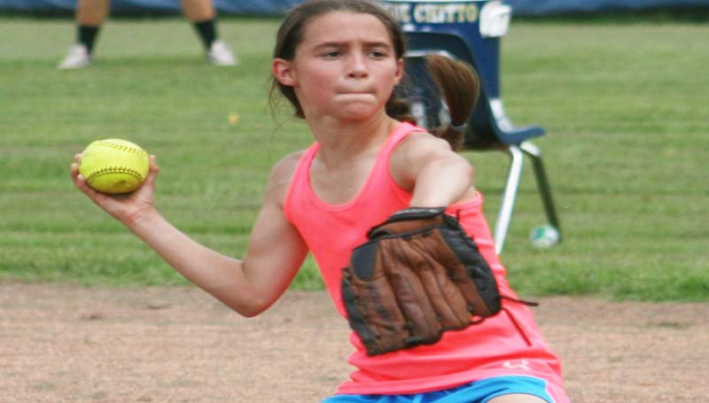 DAILY LEADER / MARTY ALBRIGHT / Aubrey Britt works on her skills in the infield as she prepares to make a throw to first base in Bogue Chitto's two-day softball camp.