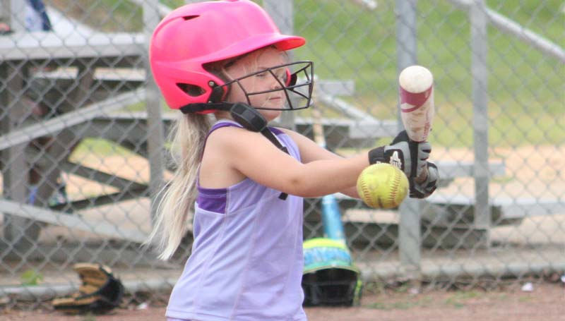 DAILY LEADER / MARTY ALBRIGHT / Layla Burt practices her bunting technique during a drill in BC's camp. BC had a big turnout for the two-day camp, which concludes today.