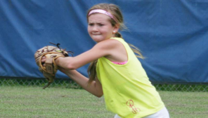 DAILY LEADER / MARTY ALBRIGHT / Rainie Welch works on her throwing technique from the outfield in Bogue Chitto's softball camp. Coach Scott Leggett and his softball Lady Cats hosted the two-day camp to teach the fundamentals of softball to girls in the K-6 grades.