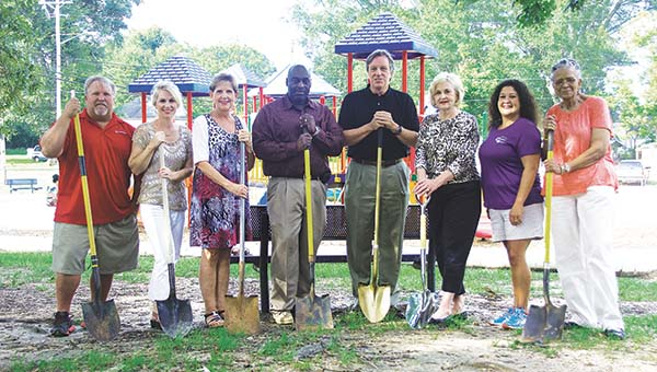 DAILY LEADER / KATIE WILLIAMSON / The Healthy Hometown Committee breaks ground on the new walking trail at Bicentennial Park. Participating are (from left) Todd Peavey, physiotherapist/director with King's Daughters Medical Fitness Center; Lorie Carter, project director with Mississippi Tobacco Free Coalition Lincoln/Copiah County; Debbie Smith, owner/instructor of Curves of Brookhaven; Randy Belcher, Ward One alderman; Joe Cox, mayor of Brookhaven; Karen Sullivan, alderman at large; Elizabeth Smith, with KDMC Performance Center; and Carolyn Reed, progam assistant at the Furlow Senior Center.
