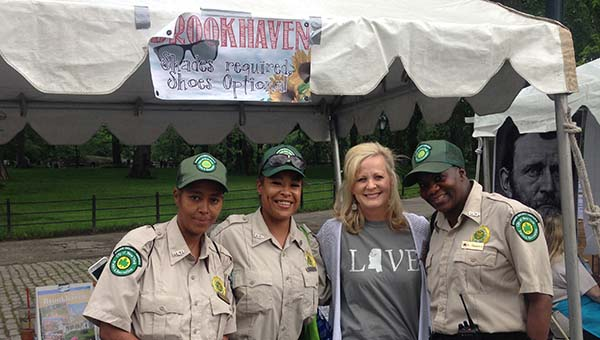 PHOTO SUBMITTED / Kay Burton, representing Brookhaven and Hometown Mississippi Retirement Communities, poses for a picture with New York Central Park rangers at the Mississippi Picnic in New York City Saturday. Burton said the cookies she brought for the event were a big hit with the rangers.